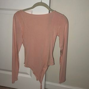 Baby pink body suit (worn maybe once or twice)